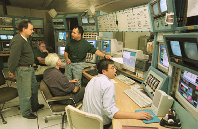 people in a control room