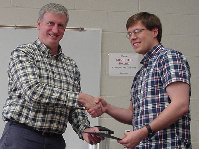 [photo of J Glick receiving 2015 Graduate TA Award]