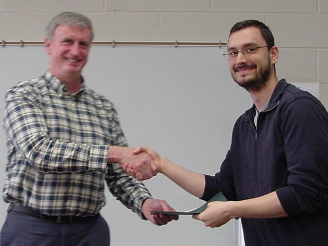 [photo of M Obsniuk receiving 2015 Graduate TA Award]