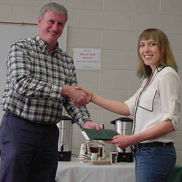 [photo of C Wendeln receiving 2015 Undergrad TA Award]