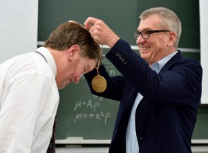 [photo of Prof. Huston receiving honorary medallion]