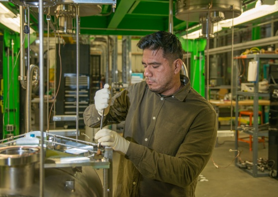 FRIB Graduate Student Crispin Contreras works on a superconducting radio frequency cavity in FRIB's processing facility.