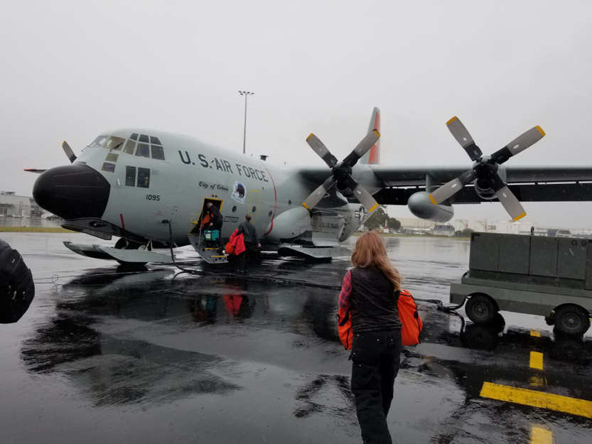 "Rysewyk boarding the C-130 cargo plane that took IceCubers and other visitors from Christchurch, New Zealand, to NSF's McMurdo Station. Three attempts were needed to make the trip successfully after ""boomeranging,"" turning around mid-flight due to weather complications."