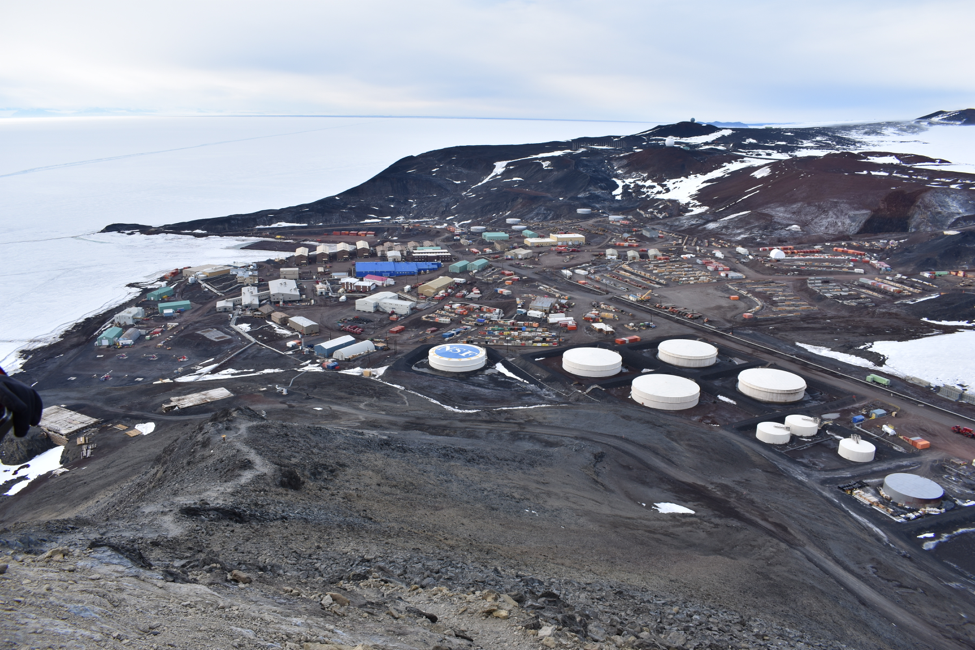 NSF's McMurdo Station, located on southern coast of Ross Island in Antarctica, from the summit of Observation Hill. Rysewyk and teammates spent some time exploring the terrain around the station while their flight from McMurdo to the Pole was delayed by bad weather.